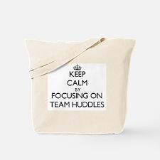 Keep Calm by focusing on Team Huddles Tote Bag