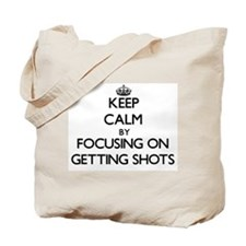 Keep Calm by focusing on Getting Shots Tote Bag