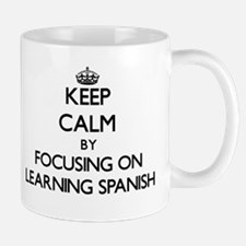 Keep Calm by focusing on Learning Spanish Mugs