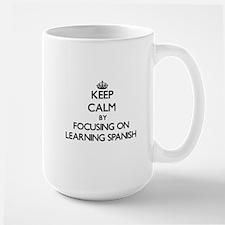 Keep Calm by focusing on Learning Spanish Mugs