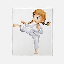 A brave girl doing karate Throw Blanket