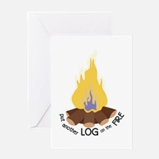 Log On The Fire Greeting Cards