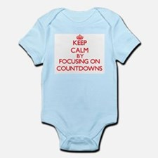 Keep Calm by focusing on Countdowns Body Suit