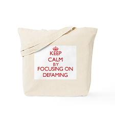 Keep Calm by focusing on Defaming Tote Bag