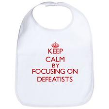 Keep Calm by focusing on Defeatists Bib
