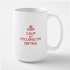 Keep Calm by focusing on Defying Mugs