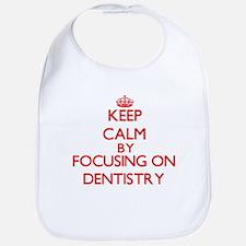 Keep Calm by focusing on Dentistry Bib