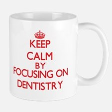 Keep Calm by focusing on Dentistry Mugs