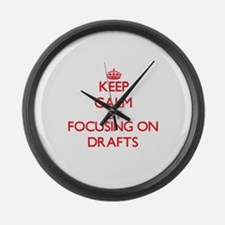 Keep Calm by focusing on Drafts Large Wall Clock