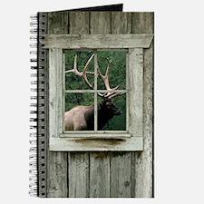 Old wood cabin window with bull elk Journal