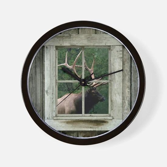 Old wood cabin window with bull elk Wall Clock