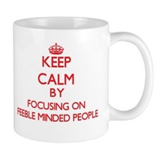 Keep Calm by focusing on Feeble Minded People Mugs