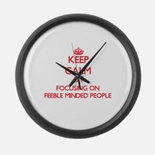 Keep Calm by focusing on Feeble M Large Wall Clock