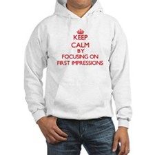 Keep Calm by focusing on First I Hoodie