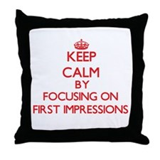 Keep Calm by focusing on First Impres Throw Pillow