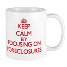 Keep Calm by focusing on Foreclosures Mugs