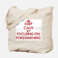Keep Calm by focusing on Forewarning Tote Bag