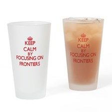 Keep Calm by focusing on Frontiers Drinking Glass