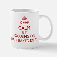 Keep Calm by focusing on Half-Baked Ideas Mugs