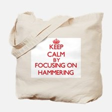 Keep Calm by focusing on Hammering Tote Bag