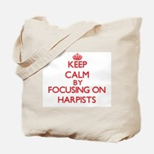 Keep Calm by focusing on Harpists Tote Bag