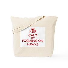 Keep Calm by focusing on Hawks Tote Bag