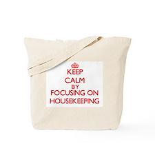 Keep Calm by focusing on Housekeeping Tote Bag