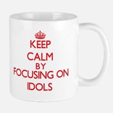 Keep Calm by focusing on Idols Mugs