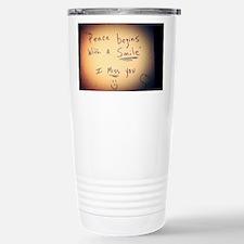 Peace begins with a smi Travel Mug