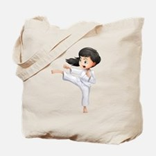 A young woman doing karate Tote Bag