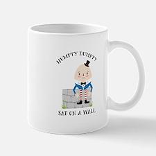 Sat On A Wall Mugs