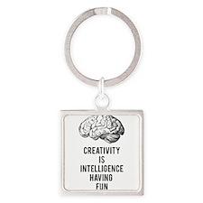 creativity is intelligence having fun Keychains