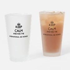 Keep calm and kiss the Internationa Drinking Glass