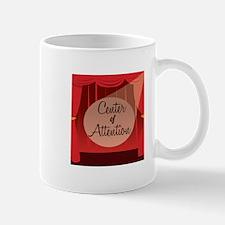 Center Of Attention Mugs