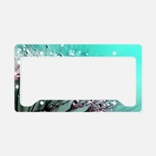 Cool Dandelion seeds blowing in the wind License Plate Holder