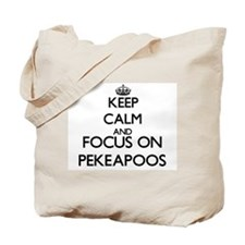 Keep calm and focus on Pekeapoos Tote Bag