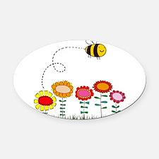 Bee Buzzing a Flower Garden Oval Car Magnet