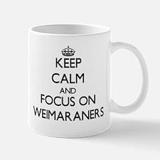 Keep calm and focus on Weimaraners Mugs