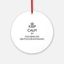 Keep calm by focusing on Deutsch Ornament (Round)