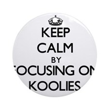 Keep calm by focusing on Koolies Ornament (Round)