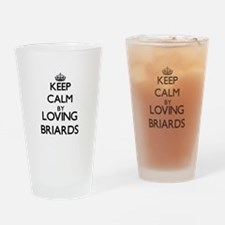 Keep calm by loving Briards Drinking Glass