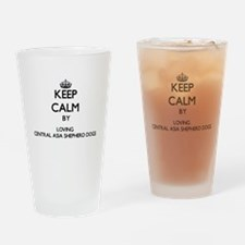 Keep calm by loving Central Asia Sh Drinking Glass