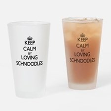 Keep calm by loving Schnoodles Drinking Glass