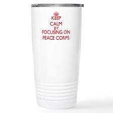 Keep Calm by focusing o Travel Coffee Mug