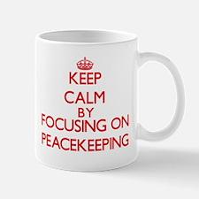 Keep Calm by focusing on Peacekeeping Mugs