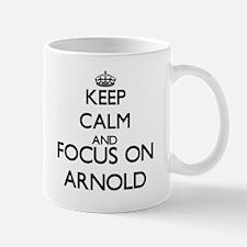 Keep Calm and Focus on Arnold Mugs