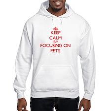 Keep Calm by focusing on Pets Hoodie