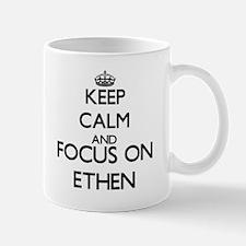 Keep Calm and Focus on Ethen Mugs