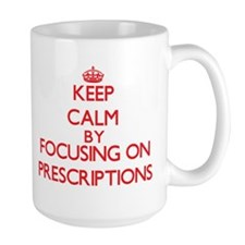 Keep Calm by focusing on Prescriptions Mugs