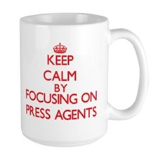 Keep Calm by focusing on Press Agents Mugs